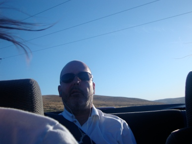Dad listening to an audio book while we drove my convertible to Spokane.