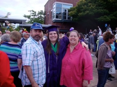 Dad, myself, and Mom at my high school graduation.