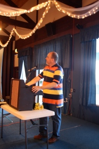 Dad giving a speech about my grandma (his mother-in-law) at her 70th birthday party.
