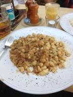 Noodle dumplings with sauerkraut and buttermilk.