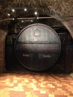 The very large barrel of wine.