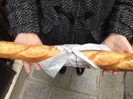 Wrapped in the French way with just a bit of paper to keep the butter from oozing on your hands.